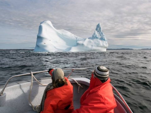 Iceberg watching in an open boat