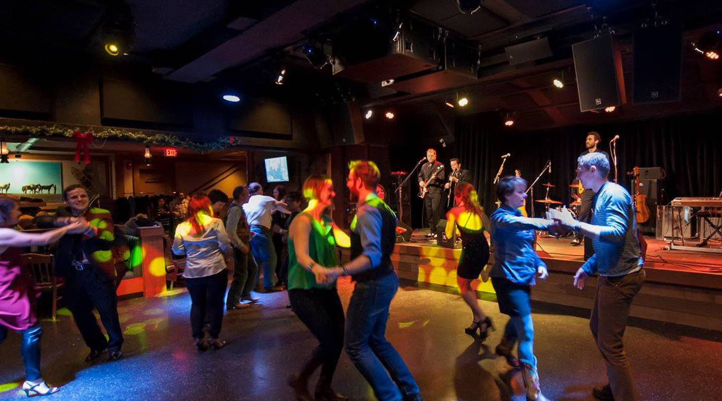 Rollicking house band, two-step instructors and line dancers gets everyone up on their feet