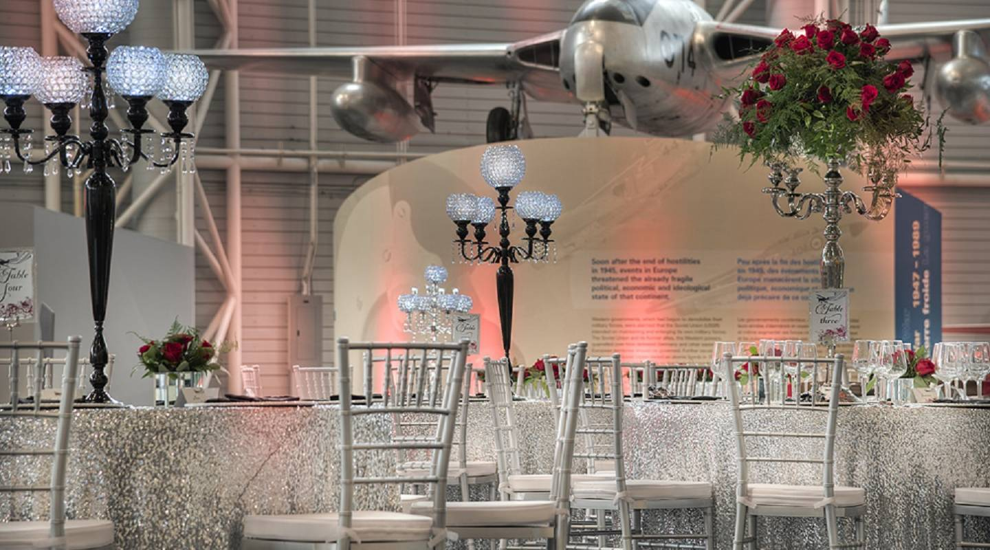 Elegantly appointed cocktail and banquet tables juxtapose aircraft from early to modern age of flight